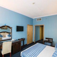 Отель Sun And Sand Clock Tower Дубай удобства в номере фото 2