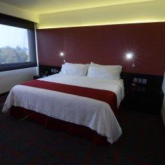 Отель Holiday Inn Dali Airport Мехико комната для гостей фото 5