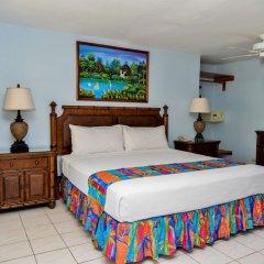 Отель CocoLaPalm Seaside Resort Ямайка, Саванна-Ла-Мар - 1 отзыв об отеле, цены и фото номеров - забронировать отель CocoLaPalm Seaside Resort онлайн комната для гостей фото 2