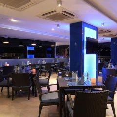 Отель Absolute Twin Sands Resort & Spa гостиничный бар