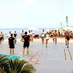 Отель The Royal Apollonia пляж фото 2