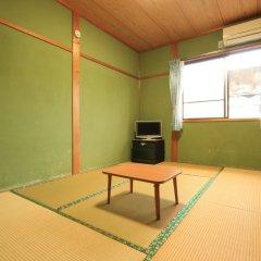 Отель Minshuku Miyanourasou Якусима комната для гостей фото 2