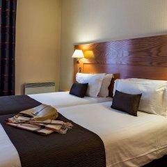Hotel Le Magellan комната для гостей