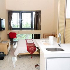 Shengang Hotel Apartment Yuhedi Branch Шэньчжэнь комната для гостей фото 4