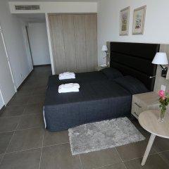 Отель Dionysos Central Hotel Кипр, Пафос - отзывы, цены и фото номеров - забронировать отель Dionysos Central Hotel онлайн комната для гостей
