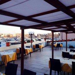 Отель Sbarcadero Hotel Италия, Сиракуза - отзывы, цены и фото номеров - забронировать отель Sbarcadero Hotel онлайн питание
