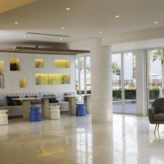 Отель Sealine Beach - a Murwab Resort Катар, Месайед - отзывы, цены и фото номеров - забронировать отель Sealine Beach - a Murwab Resort онлайн интерьер отеля