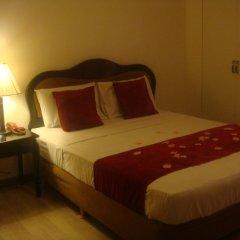Отель Green Suites at Bel Air Soho Филиппины, Макати - отзывы, цены и фото номеров - забронировать отель Green Suites at Bel Air Soho онлайн комната для гостей фото 5