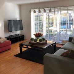 Отель Vink Water View Apartment Нидерланды, Винкевеен - отзывы, цены и фото номеров - забронировать отель Vink Water View Apartment онлайн комната для гостей фото 5