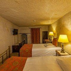Отель Yunak Evleri - Special Class сейф в номере