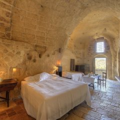 Отель Sextantio Le Grotte Della Civita Матера комната для гостей фото 5
