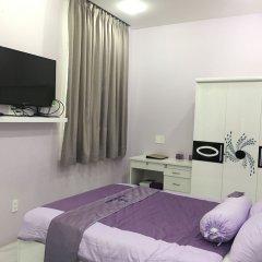 Отель HT Apartment Вьетнам, Хошимин - отзывы, цены и фото номеров - забронировать отель HT Apartment онлайн комната для гостей фото 4