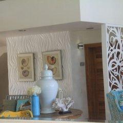 Отель Costa Atlantica Beach Condos Доминикана, Пунта Кана - отзывы, цены и фото номеров - забронировать отель Costa Atlantica Beach Condos онлайн интерьер отеля фото 3