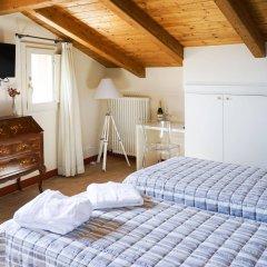 Отель Casa Isolani Santo Stefano Италия, Болонья - отзывы, цены и фото номеров - забронировать отель Casa Isolani Santo Stefano онлайн комната для гостей фото 2