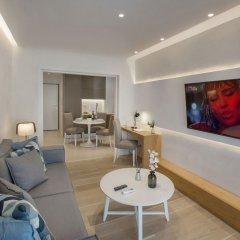 Апартаменты Lovely apartment close to Acropolis by GHH Афины комната для гостей фото 4