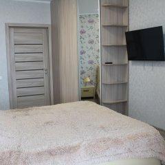 Апарт-Отель Столичный Тюмень комната для гостей