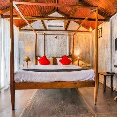Отель Capital O 41974 Village Susegat Beach Resort Гоа комната для гостей фото 3