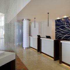Отель Courtyard by Marriott Dubai Green Community в номере