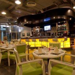 Отель Montgomerie Links Villas гостиничный бар