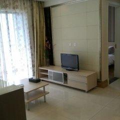 Отель Pinjing Guanghong Tianqi Apartment - Guangzhou Китай, Гуанчжоу - отзывы, цены и фото номеров - забронировать отель Pinjing Guanghong Tianqi Apartment - Guangzhou онлайн комната для гостей фото 4