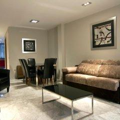 Отель Apartamentos CITIZENTRAL Juristas комната для гостей фото 3