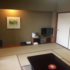 Kikuchi Kanko Hotel Минамиогуни в номере