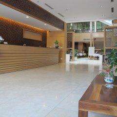Nhi Phi Hotel интерьер отеля