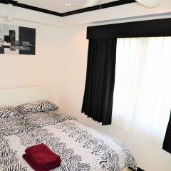Отель Stylish 2 bed Condo Jomtien Паттайя комната для гостей