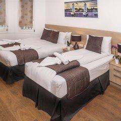 Отель 88 Studios Kensington комната для гостей