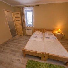 Отель Pokoje i Apartamenty Nad Potokiem Закопане комната для гостей фото 3