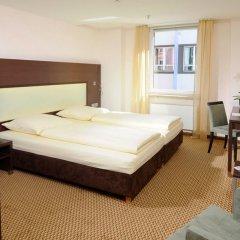 Отель Leonardo Hotel München City Center Германия, Мюнхен - 2 отзыва об отеле, цены и фото номеров - забронировать отель Leonardo Hotel München City Center онлайн комната для гостей фото 2