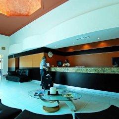 Áurea Hotel & Suites интерьер отеля