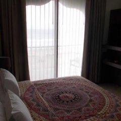 Отель Dharma Beach сейф в номере