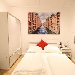Отель Central Apartment Reeperbahn Германия, Гамбург - отзывы, цены и фото номеров - забронировать отель Central Apartment Reeperbahn онлайн комната для гостей фото 4