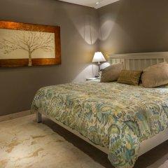 The Elements Oceanfront & Beachside Condo Hotel Плая-дель-Кармен комната для гостей фото 2