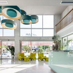 Апартаменты AxelBeach Ibiza Suites Apartments Spa and Beach Club - Adults Only интерьер отеля фото 3