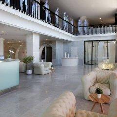 Апартаменты AxelBeach Ibiza Suites Apartments Spa and Beach Club - Adults Only интерьер отеля