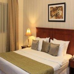 Legacy Hotel Apartments комната для гостей