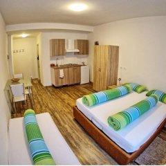 Апартаменты City Apartments Portico Меран комната для гостей фото 5