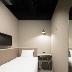 Отель another TOKYO сейф в номере