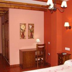 Отель Apartamentos Sierra de Segura Испания, Сегура-де-ла-Сьерра - отзывы, цены и фото номеров - забронировать отель Apartamentos Sierra de Segura онлайн удобства в номере фото 2