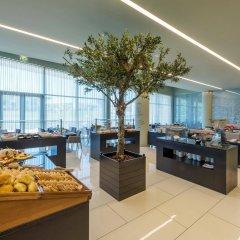Отель TRYP Lisboa Aeroporto Hotel Португалия, Лиссабон - 9 отзывов об отеле, цены и фото номеров - забронировать отель TRYP Lisboa Aeroporto Hotel онлайн питание