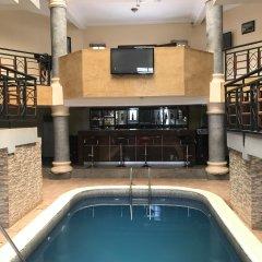 Отель Pentagon Luxury Suites Enugu Энугу бассейн