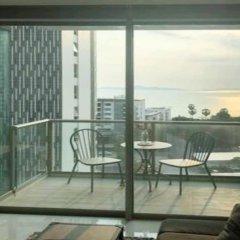 Отель Riviera Wongamat Condo By Favstay Паттайя балкон