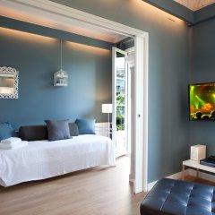 Апартаменты The Boutique Apartments комната для гостей