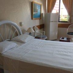 Отель Garant & Suites Бока Чика комната для гостей