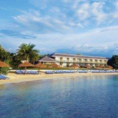Отель The Oasis at Sunset пляж