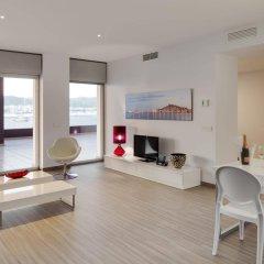 Апартаменты AxelBeach Ibiza Suites Apartments Spa and Beach Club - Adults Only комната для гостей фото 2