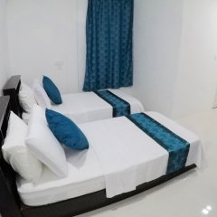 Отель Palm Lodge Остров Гасфинолу комната для гостей
