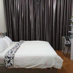 Отель Soho Suites KLCC LX Stay Малайзия, Куала-Лумпур - отзывы, цены и фото номеров - забронировать отель Soho Suites KLCC LX Stay онлайн комната для гостей
